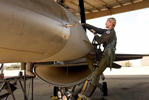 Capt Zoe Kotnik Climbs into F-16