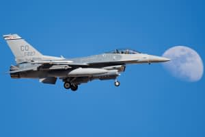 Colorado Air National Guard F-16 passing the moon during Red Flag 17-2