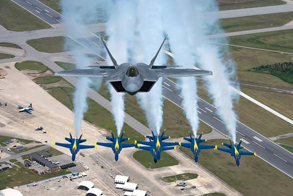 US Navy Blue Angels And F-22 Raptor Team Up For Rare Photo Flight (Updated)