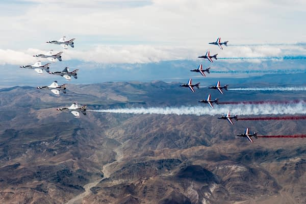 US Air Force Thunderbirds And Patrouille de France Fly Together Over Nevada